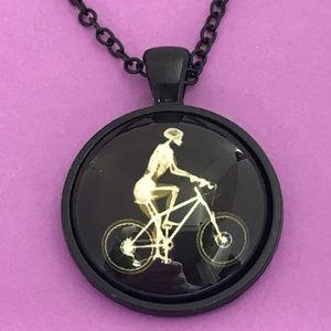Jewelry - Skeleton Riding Bike Glow in the Dark Necklace